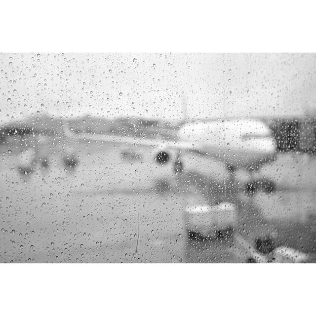 Rainy day to travel Fuji Xpro2 + Nikkor 24mm f2.8 . . . . #airport #rainyday #raindrops #airplane #travelling #flying #blackandwhite #bwphotography #bnw #monochrome #photographylife #photography📸 #grayday #throughthewindow  #lookingoutside #fujifilmx_us #myfujilove #fujixpro2 #xpro2 @_fujilove_