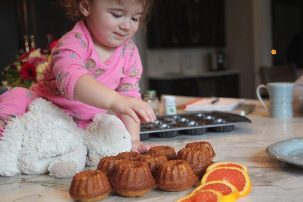 Toddler-with-Mini-Banana-Orange-Bundt-Cakes.jpg