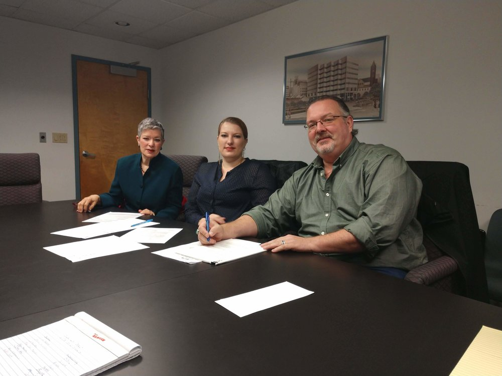 From left to right: Mary Jane, Lia & Jason happily signing the closing papers at the NJDPMC office in Trenton NJ 10/17/18.
