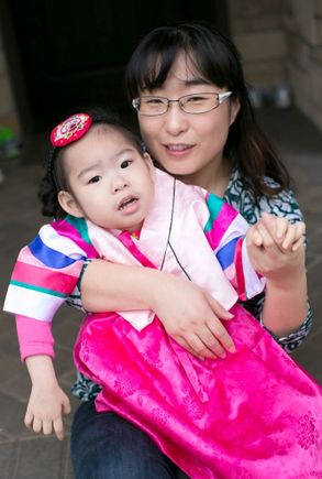 Soo-Kyung Lee, Ph.D., with her daughter Yuna. (Courtesy of the Lee family)