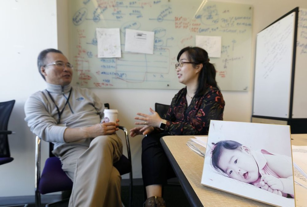 "Jae W. Lee (left) keeps a photo of his daughter Yuna on his desk. Soo (right) says their research gives them hope for their daughter. ""The ability to better understand my daughter's condition inspires me to keep moving forward. I am a more optimistic scientist because of her."" (OHSU/Kristyna Wentz-Graff)"