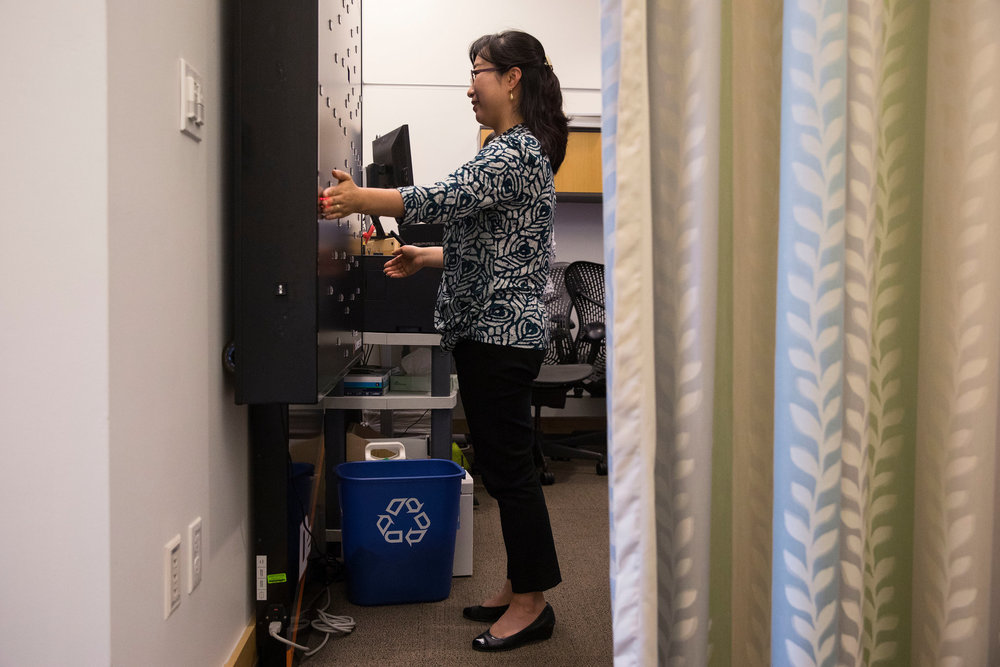 Soo-Kyung's peripheral vision being tested at an occupational therapy session. She suffered a collapse in 2016 from the stress of juggling her scientific career while caring for Yuna, and dealt with the after-effects of vertigo.CreditRuth Fremson/The New York Times