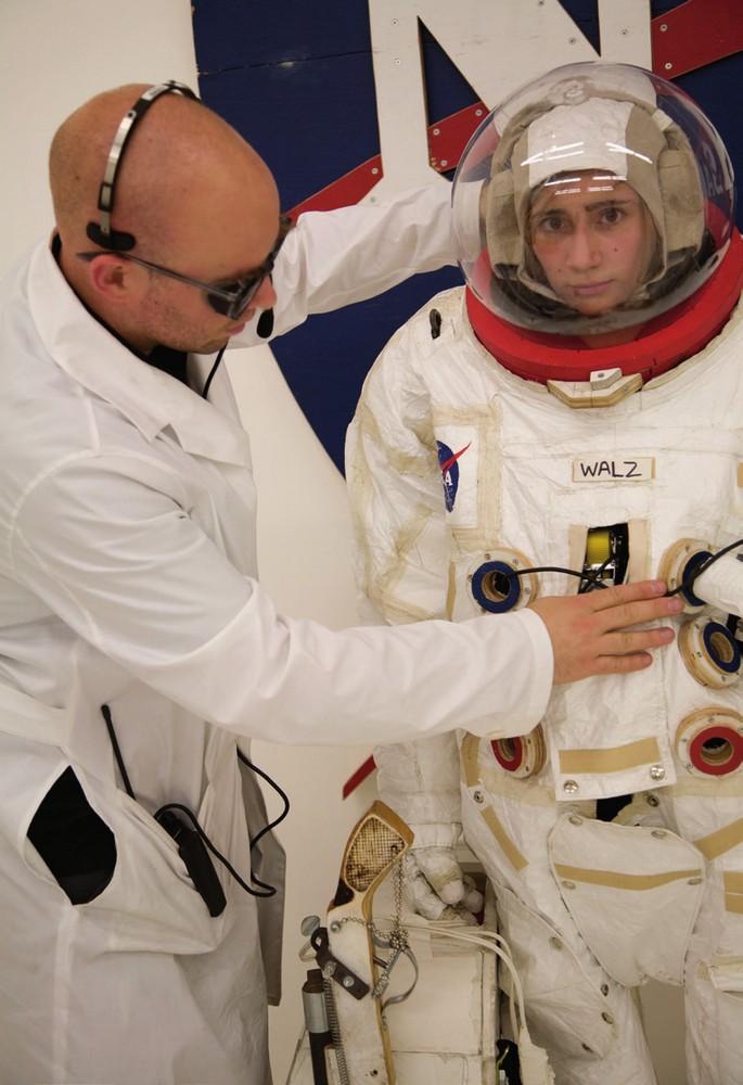 JJ PEET adjusts space suit of astronaut Addison Walz Space Program, 2007