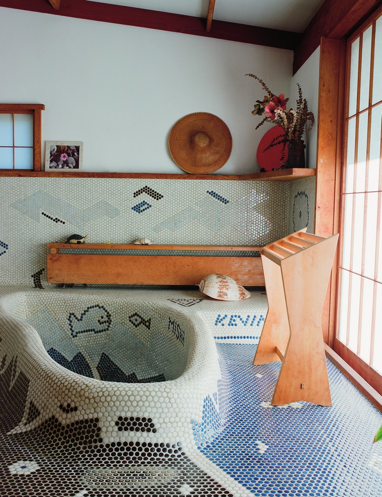 penny-tiled bathroom in the Reception House, embedded with the designer's family crest (back right) and the names of his grandchildren.  The sliding shoji door leads to a moon-viewing platform.
