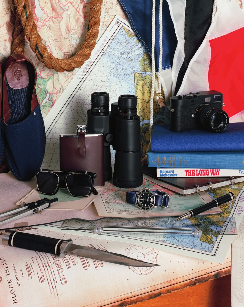 cotton toile espadrille HERMES, tradition hip flask ALFRED DUNHILL, felix havana sunglasses ILLESTEVA, geovid 8 x 56 HD binoculars LEICA, red submariner mkiv ROLEX available at manoftheworld.com, m monochrom camera LEICA, ulysse mm calfskin notebook HERMES, ringbound leather notebook HERMES, sentryman resin rollerball pen ALFRED DUNHILL, trident 2.0 knives SOG