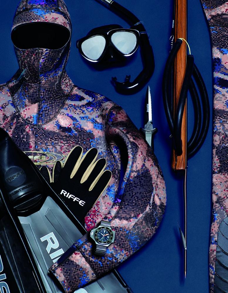 Covi-tek camouflage wet suit, neoprene gloves and dive socks, silent hunter fins, mantis mask, standard J snorkel, and E110 speargun RIFFE INTERNATIONAL, seamaster ploprof 600 m watch OMEGA available at manoftheworld.com