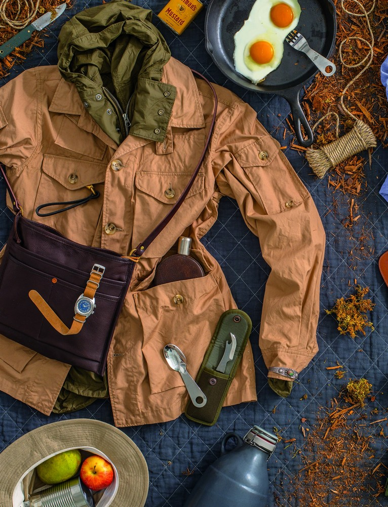 GLACIER NATIONAL PARK, MONTANA 48.6967° N, 113.7183° W  1. US army hat ORSLOW  2. explorer jacket ENGINEERED GARMENTS 3. army shell TEN C  4. oil harness shoulder bag SLOW 10. ceramic growler PORTLAND GROWLER COMPANY 11. camp cutlery set AITOR  12. vintage pigskin flask GUCCI  13. loop keychain KIKA 14. carbon steel camp knife HORSE 23. cast iron pan LODGE 25. vintage cuff MOTW  1 ― 8 available at gentrynyc.com; 9 ― 25 available at manoftheworld.com