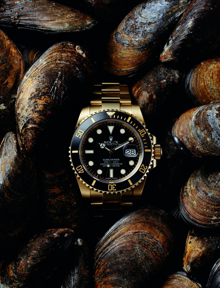 HEUER MONTREAL ROLEX SUBMARINER DATERef. 110-503B. 1969. Stainless Steel. 42 mm available at manoftheworld.comRef.: 116618LN. 2015. Oyster. Yellow gold. 40 mm.