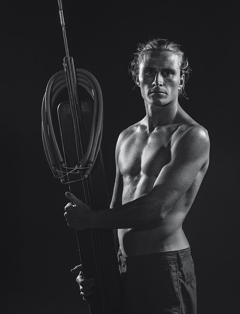 Healey and his trusty Riffe spear gun, 2015.  Photograph by Jason Reposar