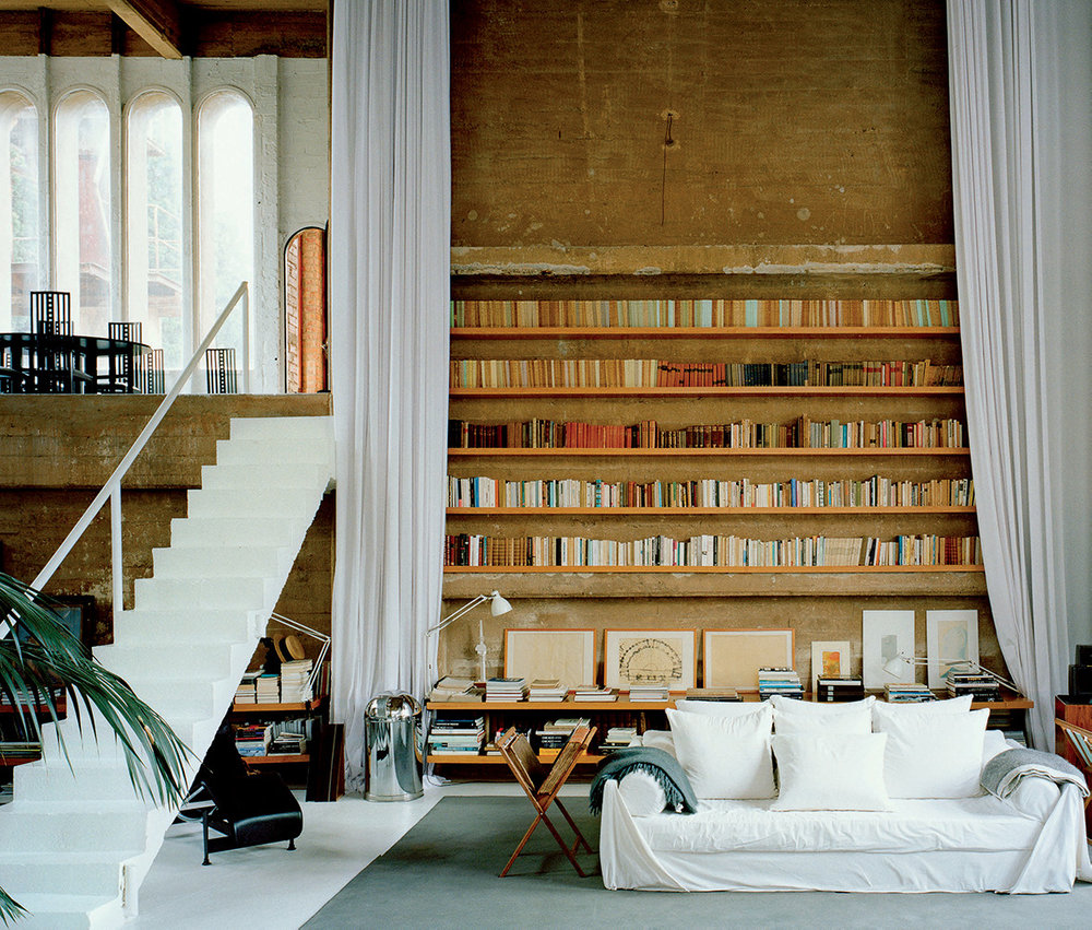 Inside the thirty thousand square foot structure, converted machine rooms and former silos house Bofill's private living quarters and the offices of his architecture firm.