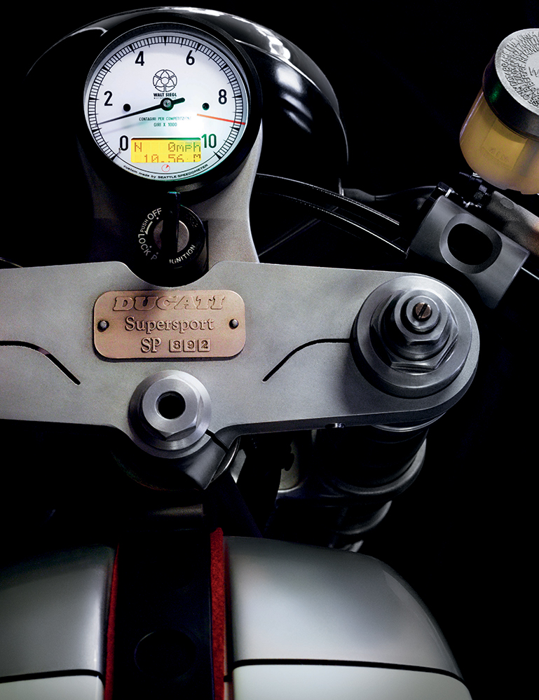 The limited-edition Ducati fork on Siegl's Leggero Seattle, with signature WSM speedometer.