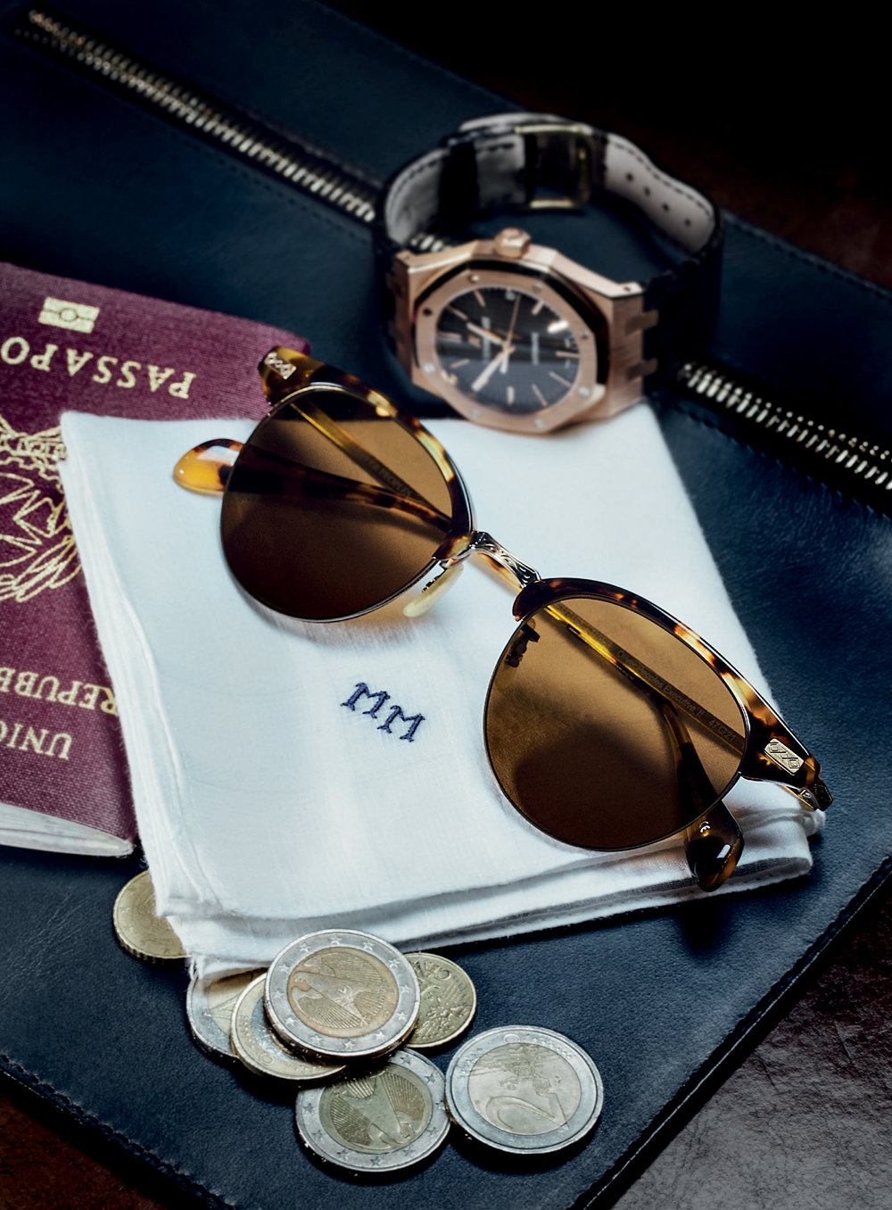 xecutive II sunglasses in dark tortoise brown acetate with brown cosmik tone lenses, antique gold ultra-thin titanium eye wire, and filigree detailing OLIVER PEOPLES  royal oak chronograph AUDEMARS PIGUET  navy leather travel pouch available at manoftheworld.com