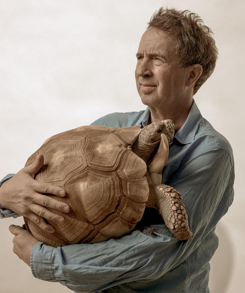 An endangered Madagascar ploughshare presses Goode's pause button.  Blue button-down shirt ARMANI