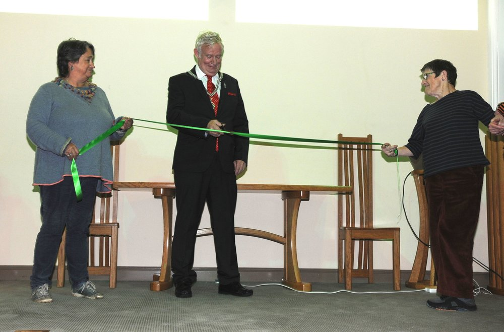 The Mayor cut a ribbon held by Tottie Aarvold (left) and Lucy Jones.