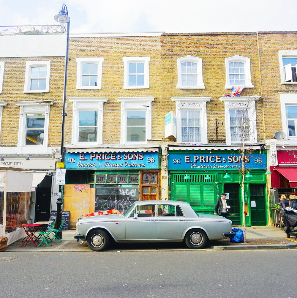 Vintage grey car on Golborne Road, in front of E. Price and Son