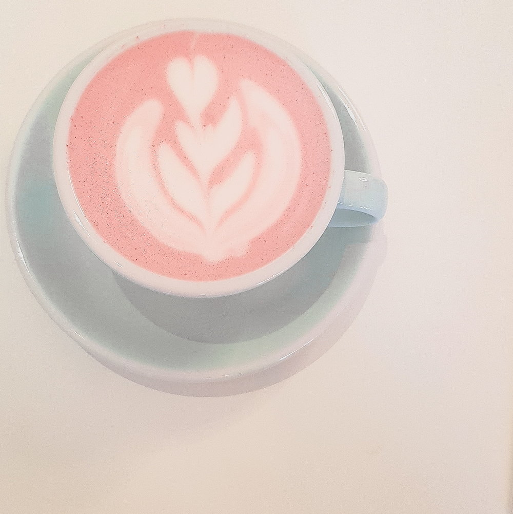 Pink Beetroot Latte in the Lefthand corner of photo. Turquoise cup and saucer