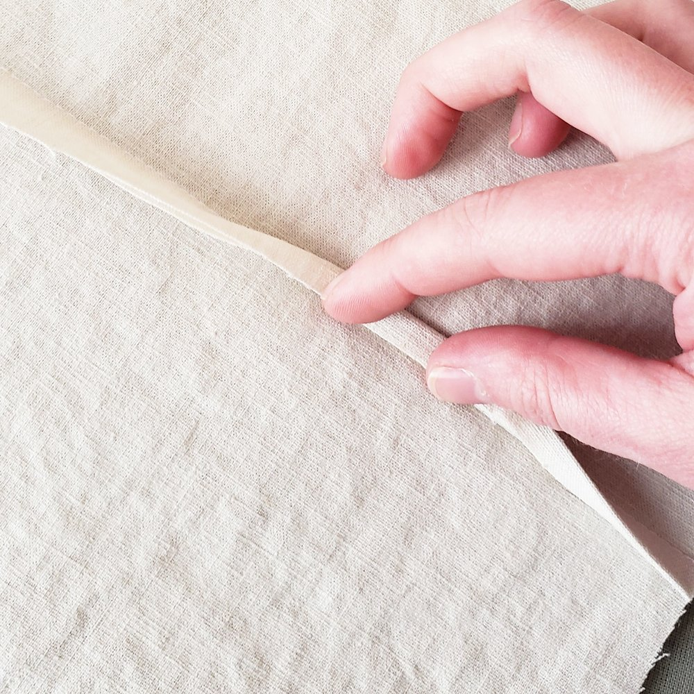 2. Fold the raw edge of the opposite side in half and over the edge you just trimmed