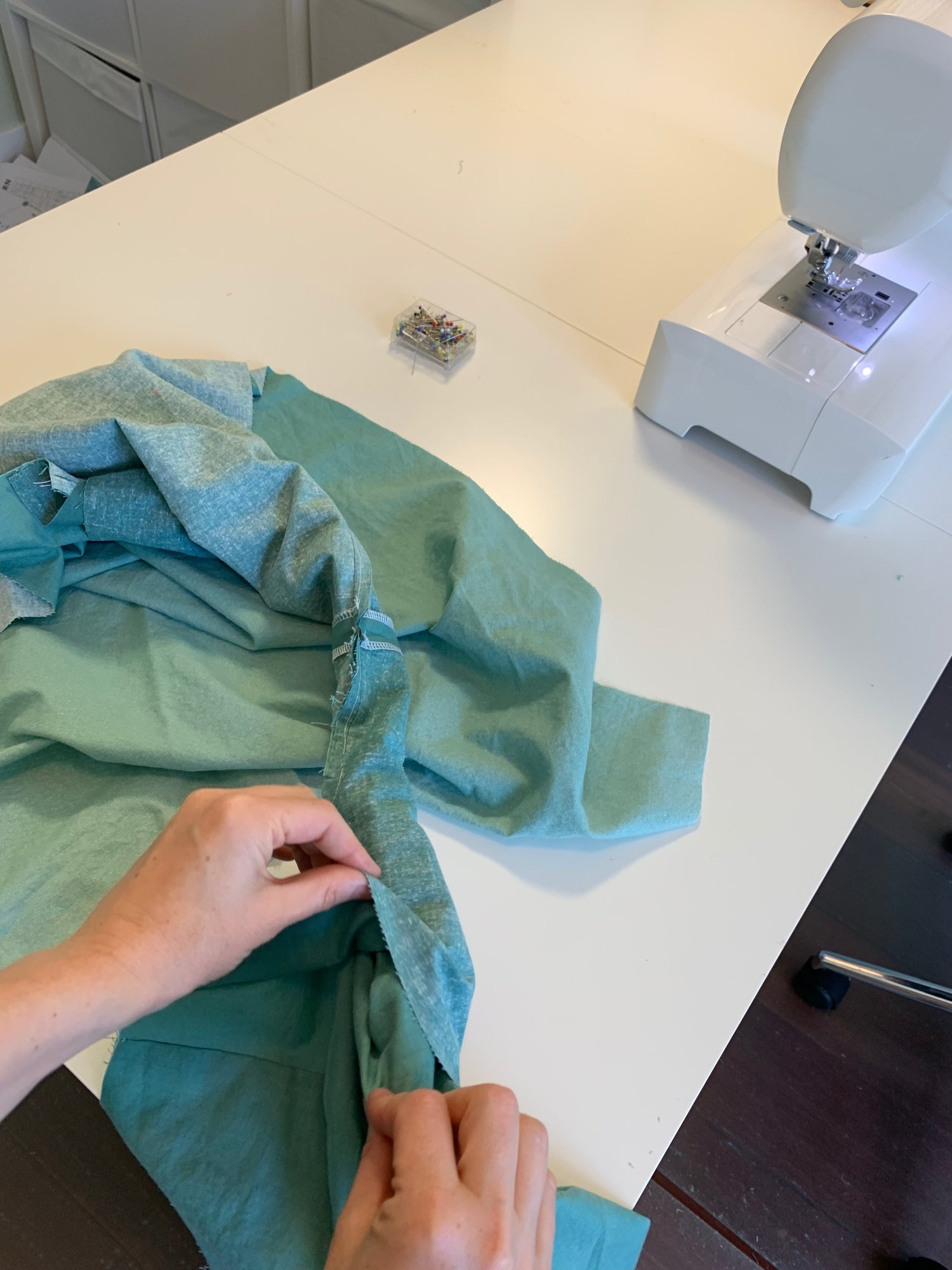 """Pulling the facing and bodice through """"burrito"""" to right side (shown here on the Version A dress)"""