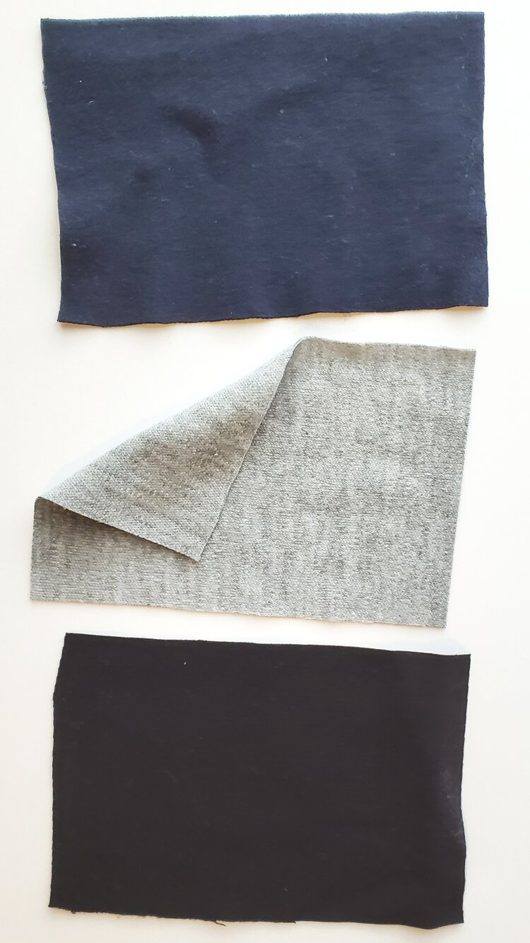 Top to bottom: navy double knit, grey Interlock knit, black Ponte. The navy double knit and black ponte have a very fine knit structure that gives the fabric a smooth, monolithic appearance.