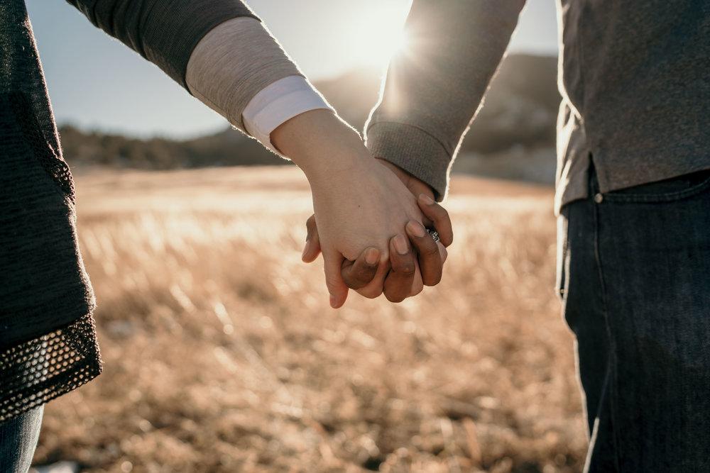 engagement photos at Chautauqua Park in Boulder holding hands close-up