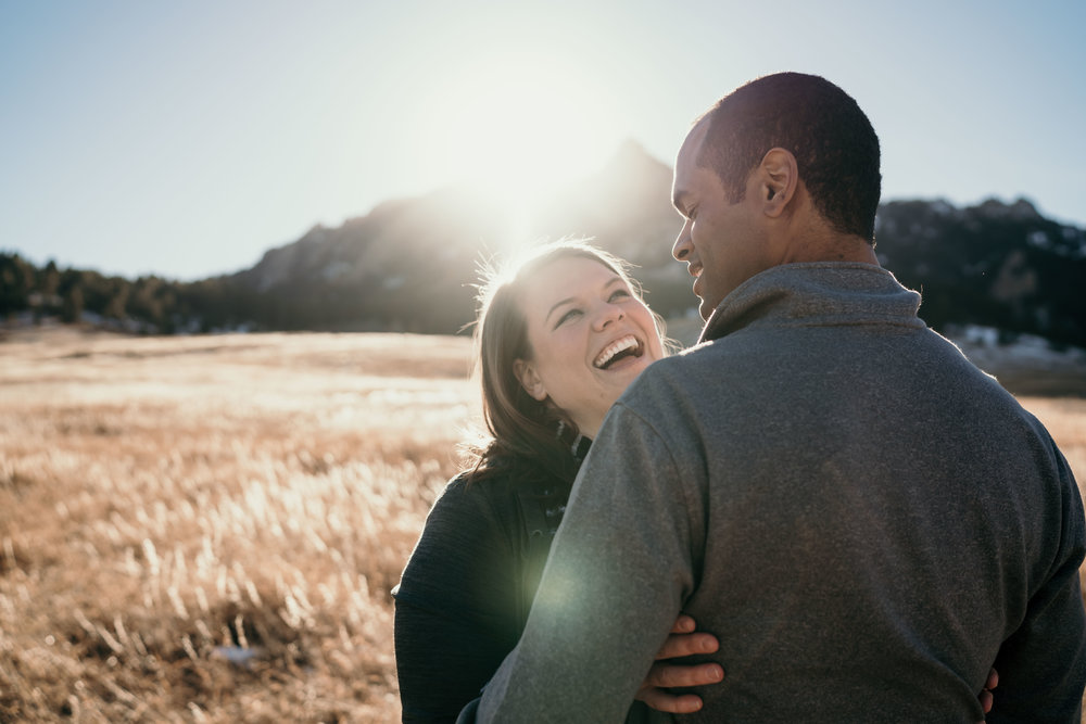 engagement photos at Chautauqua Park in Boulder Christy laughing