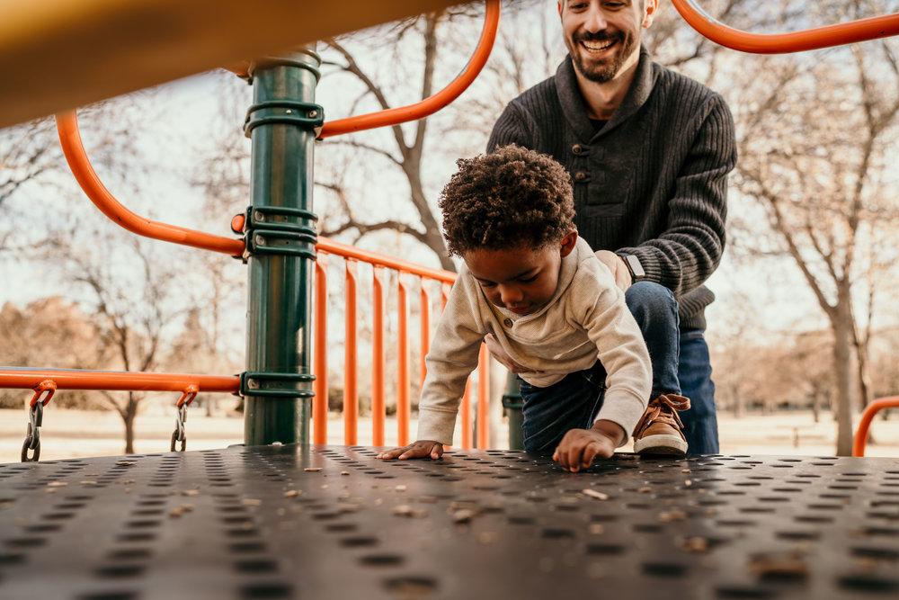 denver family photographers at city park kid on playground