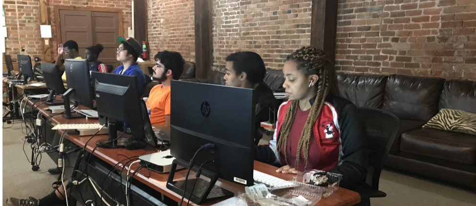 Jada Williams (right) and other high schoolers prepare to test for industry-based certifications in coding at Operation Spark this summer.