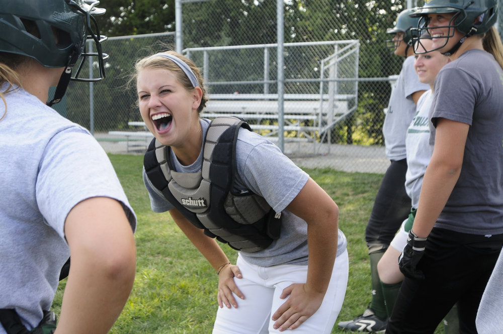 Rock Bridge softball player Samantha Bell jokes with her teammates in Columbia, MO.