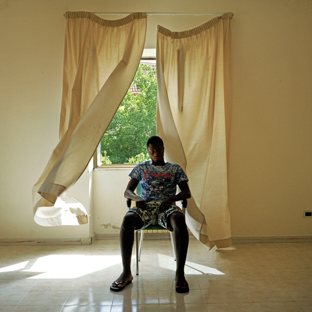 S. from Ivory Coast sits in the living room at the Aquino Zingale centre.
