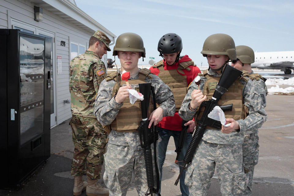 """Wisconsin Army Cadets take a break to eat """"dilly bars"""" from Dairy Queen while spending a Saturday at Fox Valley Technical College for an urban operations training event, 21 April, 2018. The cadet program teaches the students to respond to active shooters, and uses """"sets"""" designed in the fashion of motels and homes in suburbia. Many students expressed anxiety about high school shootings, and feel that training can help them be prepared in case of an emergency in their own school."""