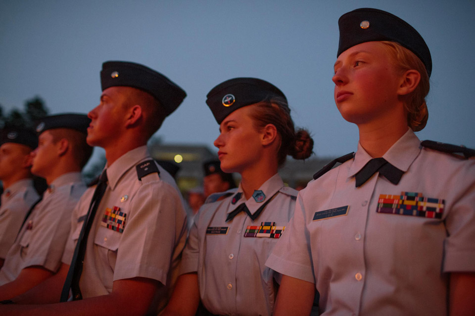 Thomas Dillon (L), Kayla Wayman (M), and Julia Lair (R) spend the evening at Mt. Rushmore for a ceremony promoting two cadets in their unit, as well as to watch a patriotic film and lighting ceremony, Keystone, South Dakota, 13 July 2017. Students from five states around the Midwest spend a week at the Civil Air Patrol Joint Dakota Encampment. The age range is 12-18, with around 60 students in attendance.