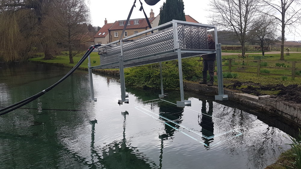 Pioneering energy blades placed in a lake linked up to a heat pump to provide heat and hot water to a large period property.