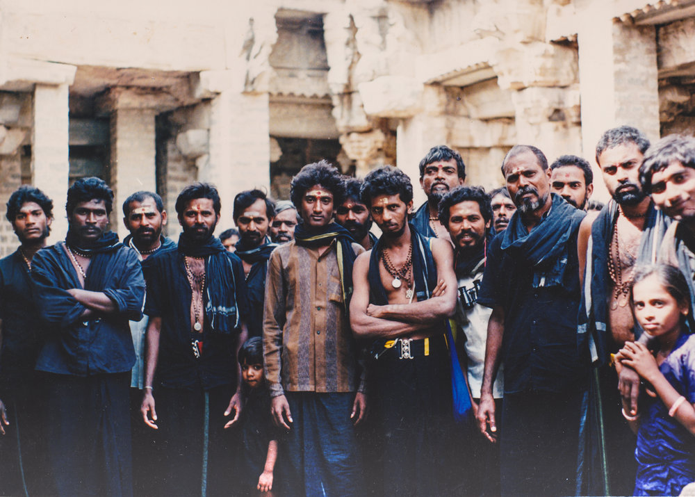 Some friendly faces - a group of mostly men on a pilgrimage in Hampi, India