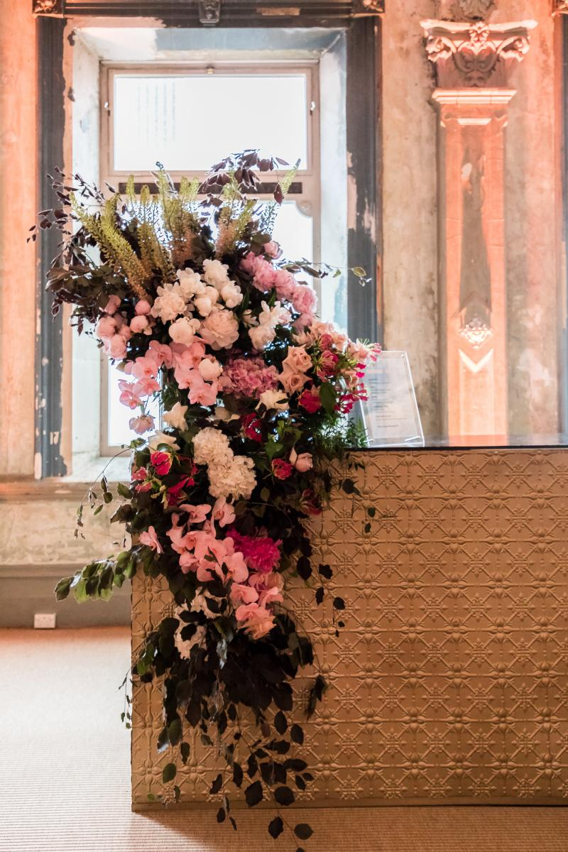 A floral setting on our brass bar - the George Ballroom Melbourne.