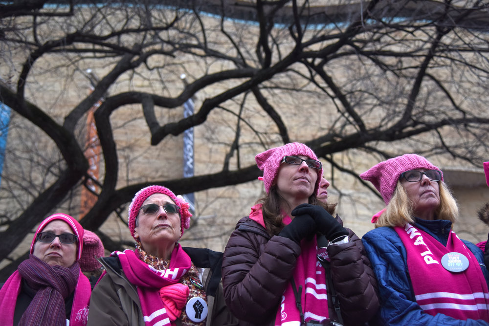 Women listen to speeches at the Women's March on Washington Saturday in Washington, D.C.