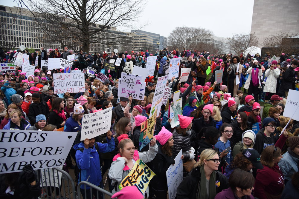 Large crowds march past the U.S. Capitol at the Women's March on Washington Saturday in Washington, D.C.