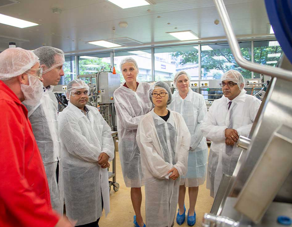 Massey University product development laboratory manager Warwick Johnson demonstrates technology with Nestlé Management and Riddet Institute research officer Dr Pranav Singh.