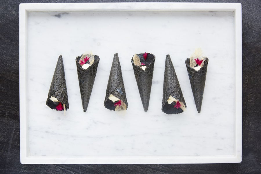 Charcoal-cone-with-pear-and-ricotta-minimalist-and-stylist-catering-by-damm-fine-food-at-the-George-Ballroom-St-Kilda.jpg