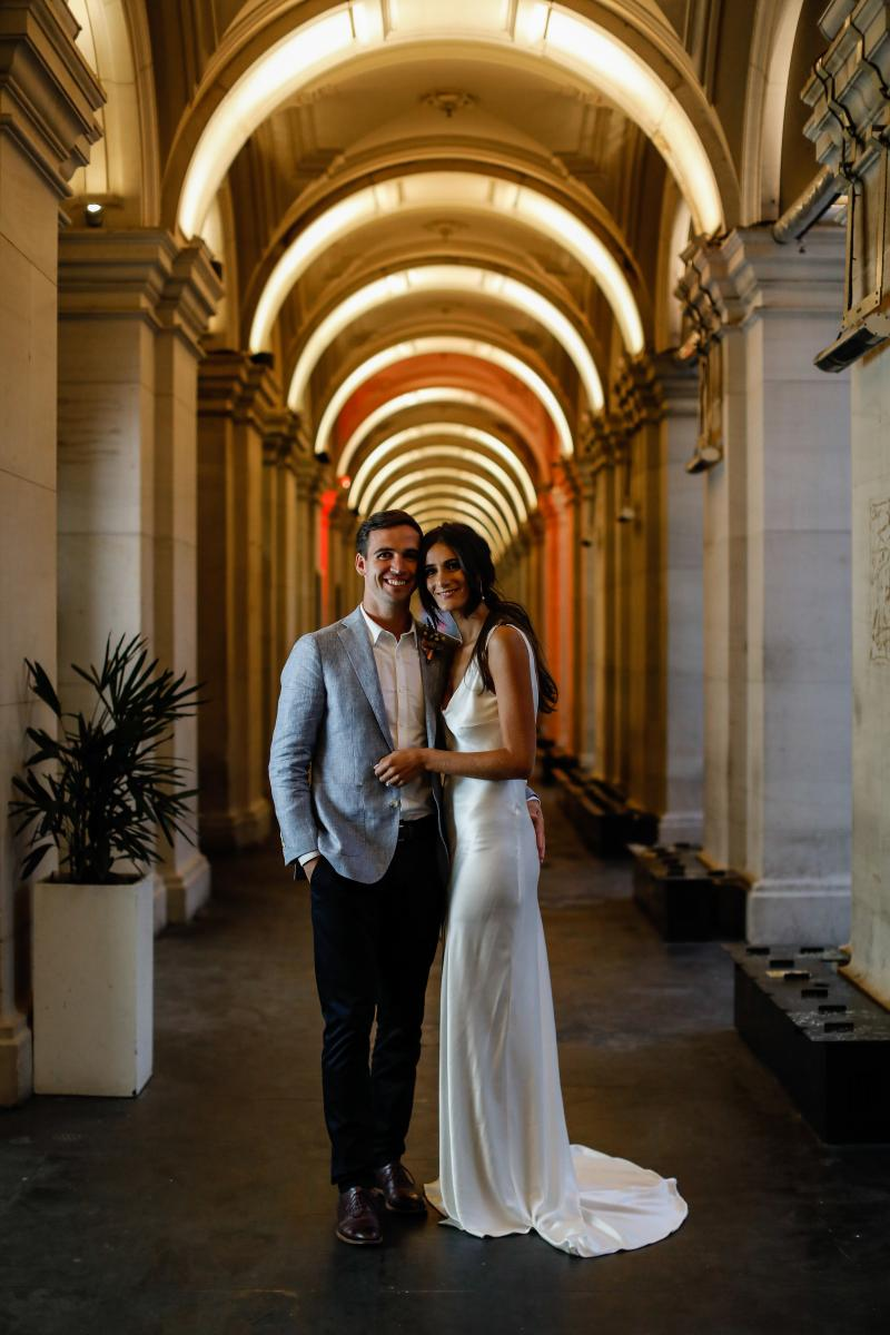 A couple taking a photo at the archways under Alto at the Melbourne GPO..jpg