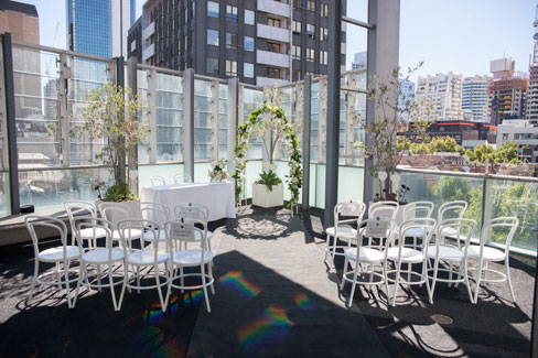Furniture setting for a wedding ceremony on the outdoor balcony at ALTO Event Space, Melbourne