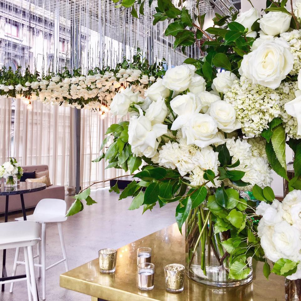 White roses hanging from the ceiling at ALTO.jpg
