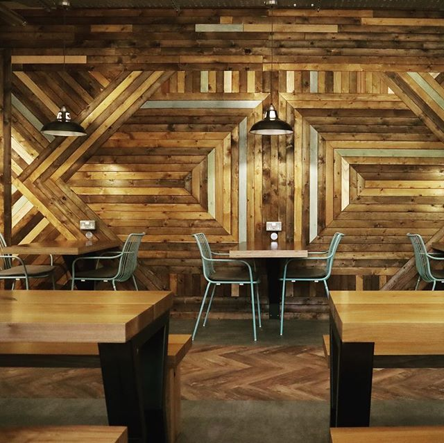 Recently finished project. Huge feature wall and some gigantic pieces of furniture.  The Shack at UWE Frenchay.  #interiordesign #bardesign #restaurantdesign #uwe #reclaimedwood #chicken #ootw  Designed and managed by @lancerscottbristol