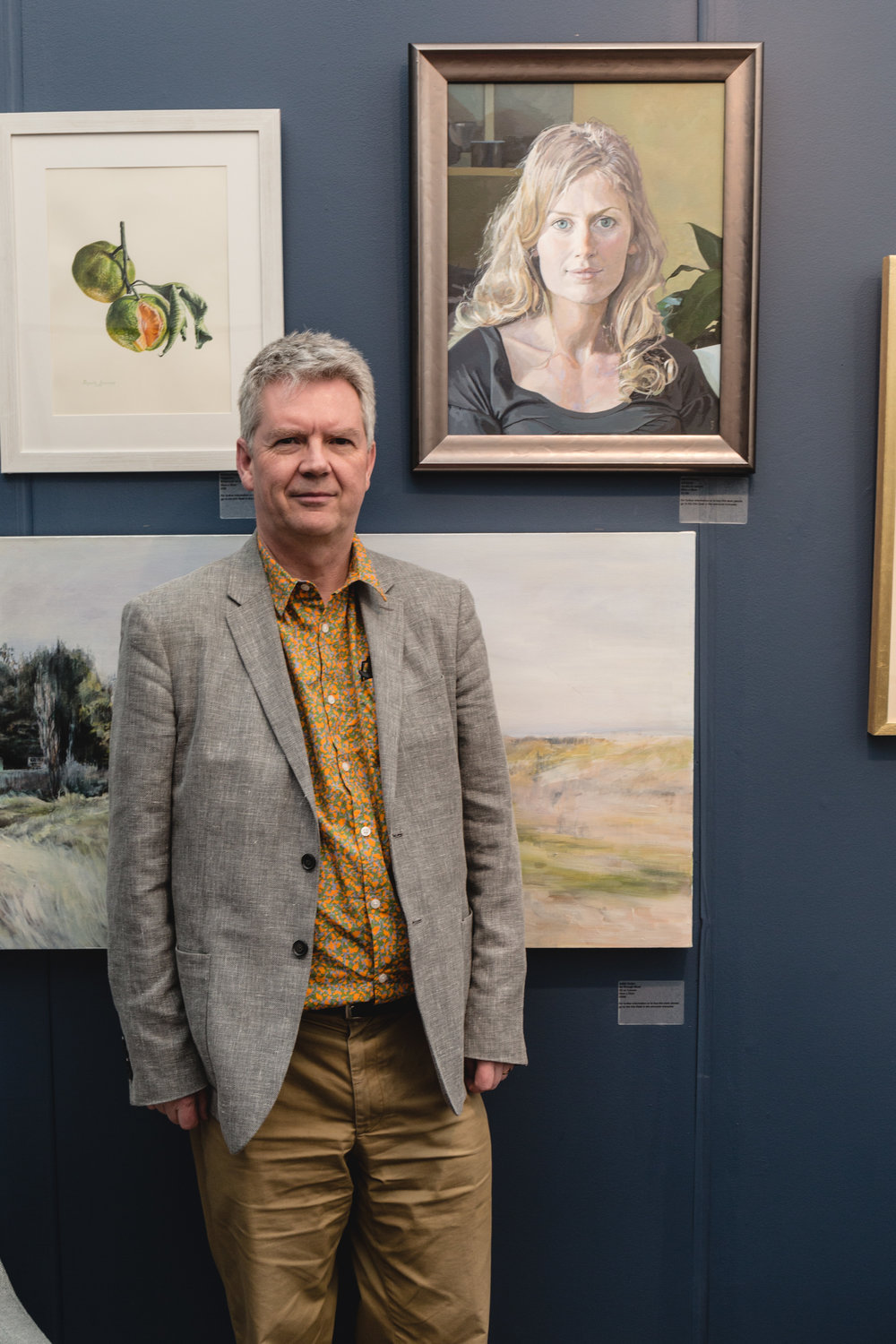 Mark Fielding next to his shortlisted painting 'Adrianna' at Battersea Affordable Art Fair