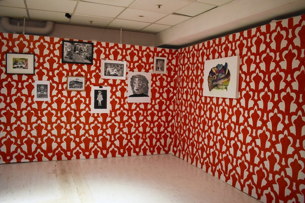 My installation: paintings and relief prints hung on hand-painted wallpaper
