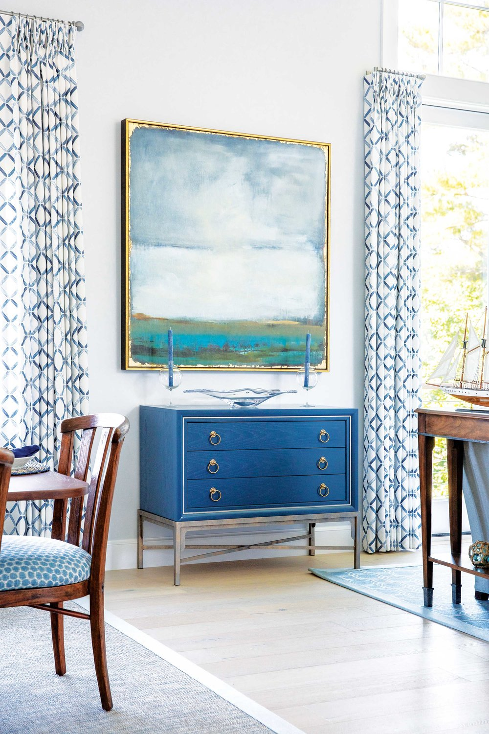 Ms. Hurlbutt's eye looks always to augment tradition. An impressionistic skyscape evokes a light summer storm, while the welded legs of a three-drawer chest inject an industrial bent.