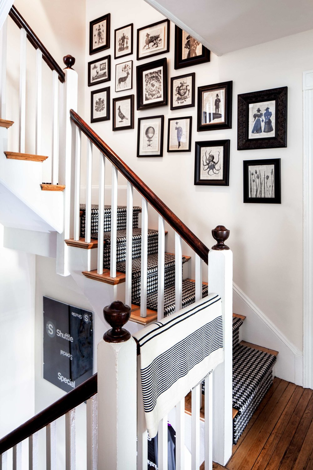 Montanaro and Saiber found frames in antique stores for the hand-stamped collages made from vintage dictionary pages that line the stair well between the second and third floors.