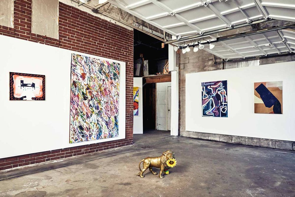 Installation view of recent New System show featuring paintings by Cody Stack.