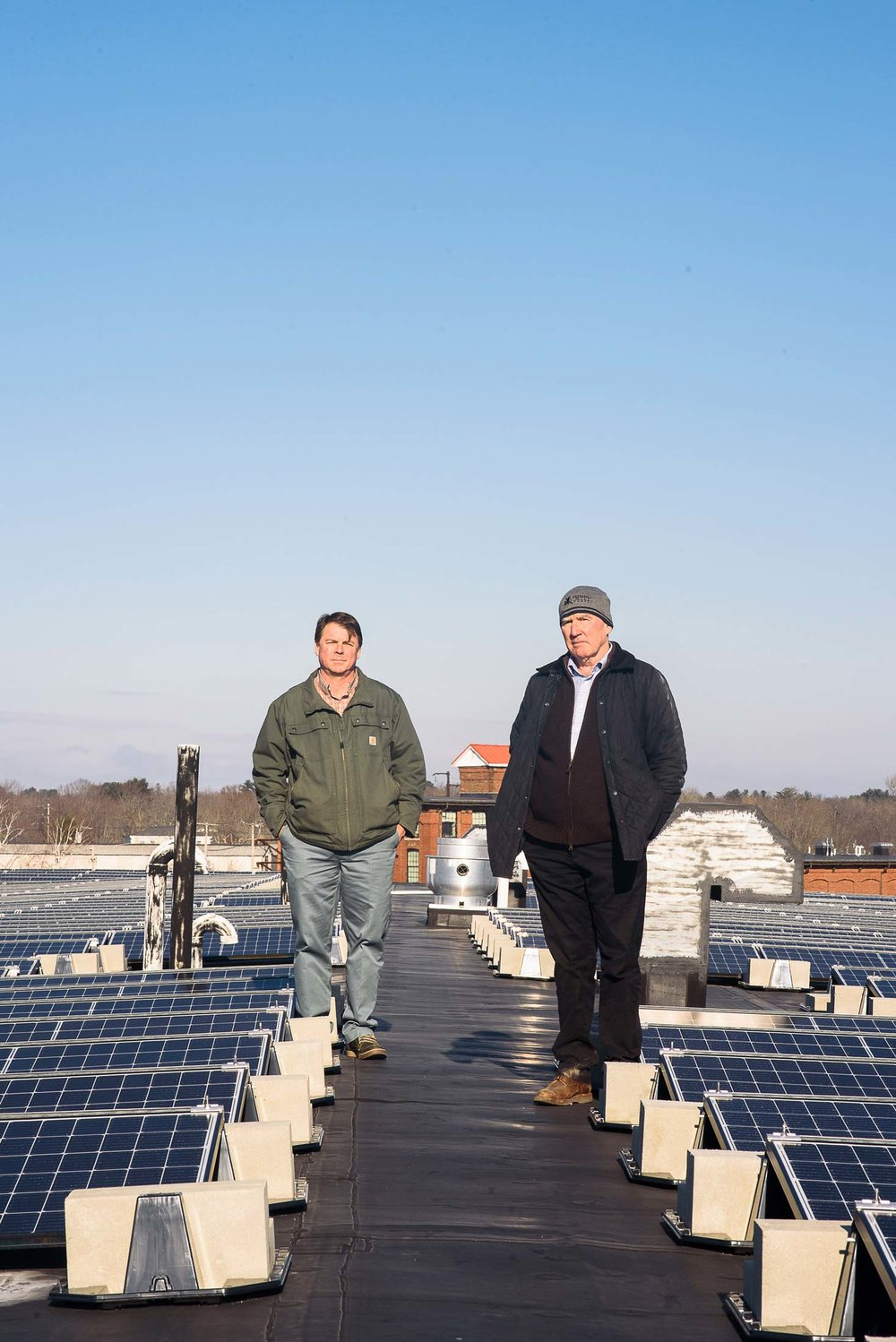 "COO Scott Joslin (left), and CEO Doug Sanford (right), beside the solar array. Johanna Sorrell, of ReVision Energy, calls the pair ""visionary."""