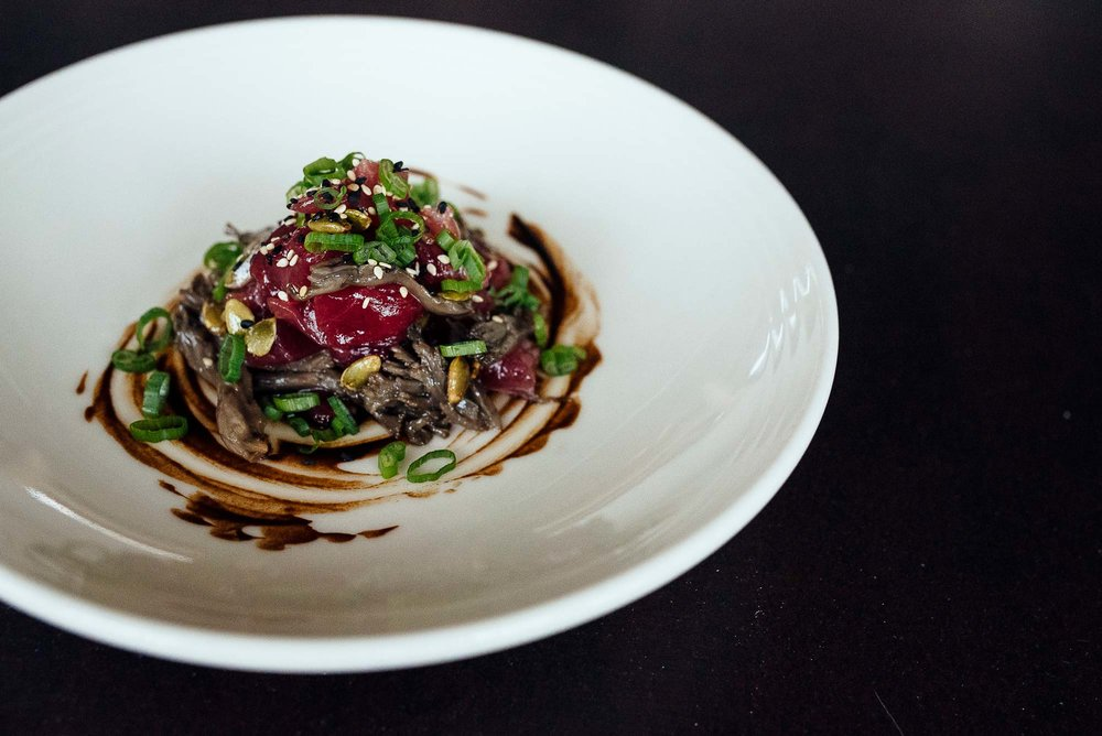 Maitake mushroom confit gives a perfect balance of texture and earthiness to the pristine tuna tartare.