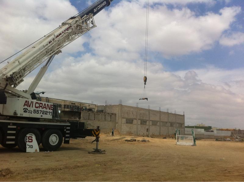 Chaja hanging from crane.jpeg
